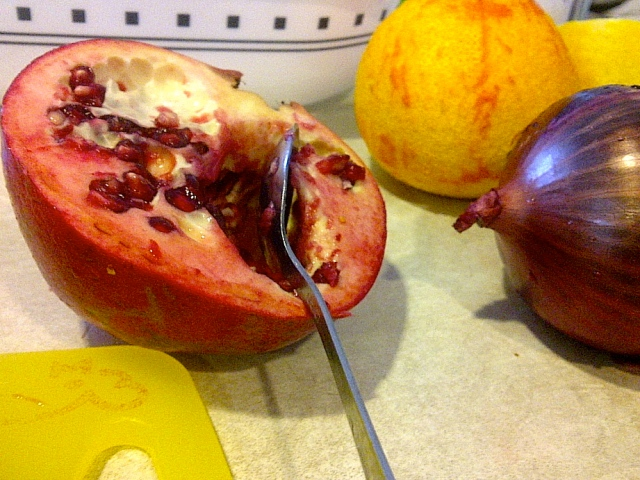 Pomegranate, half an onion and a naked orange that was not used in this recipe